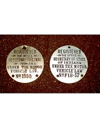 old Indiana metal dashboard discs