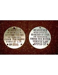 old Indiana metal dashboard discs