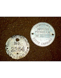 old North Carolina aluminum dashboard discs