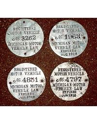 old Michigan metal dashboard discs